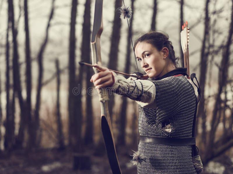 Medieval archery, woman shoot stock photos