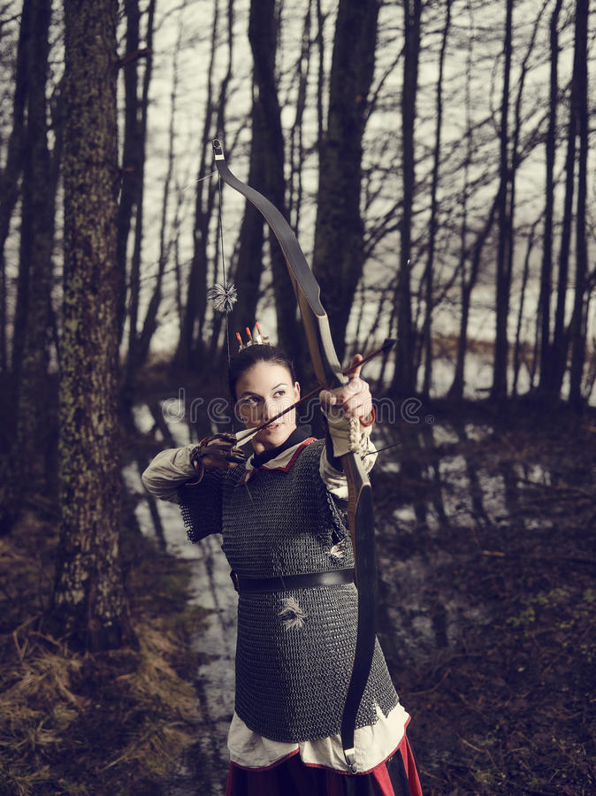 Medieval archery, woman shoot stock image