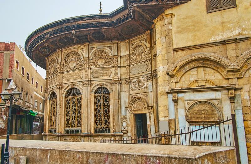 Medieval architecture of Islamic Cairo, Egypt. Ornate decorations of preserved medieval Sabil wa Kuttab of Tusun Pasha - the public fountain, located in market royalty free stock photography