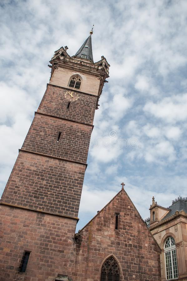 Medieval architecture in Obernai The chapel tower. Medieval architecture in Obernai in Alsace France. The chapel tower on beautiful cloudy sky background royalty free stock image