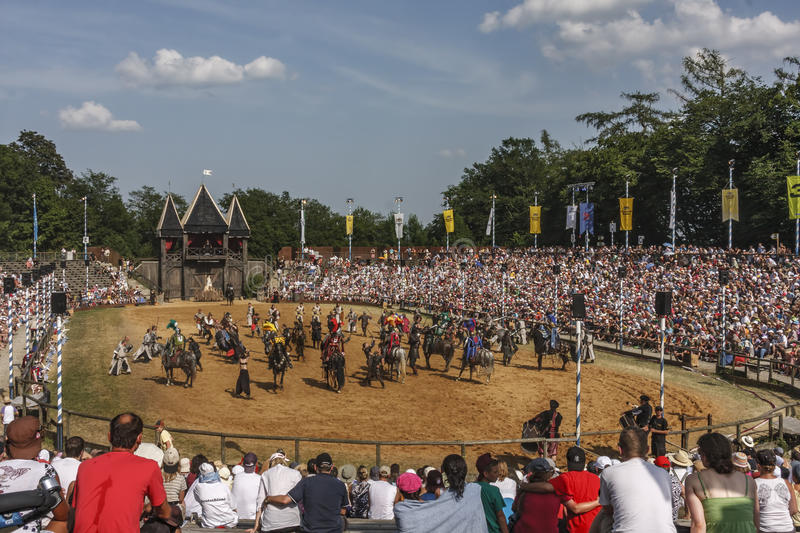 Medieval arena. Crowded arena saluting the medieval troupe at the medieval festival at Kaltinger, Germany stock photography