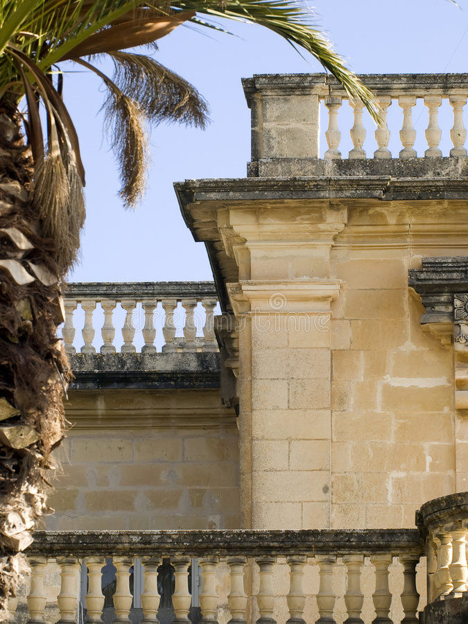 Medieval Baroque Facade. A medieval limestone facade in traditional baroque style in Mdina on the island of Malta royalty free stock photo