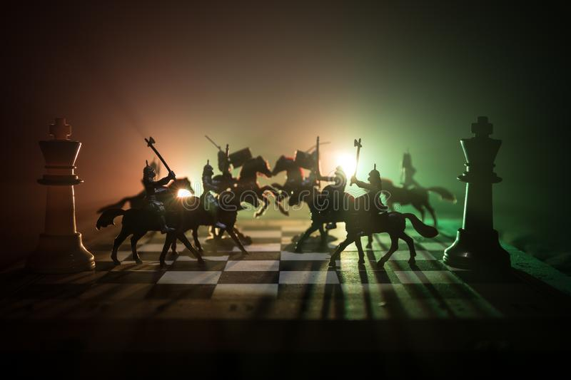 Medieval battle scene with cavalry and infantry on chessboard. Chess board game concept of business ideas and competition and stra royalty free stock image