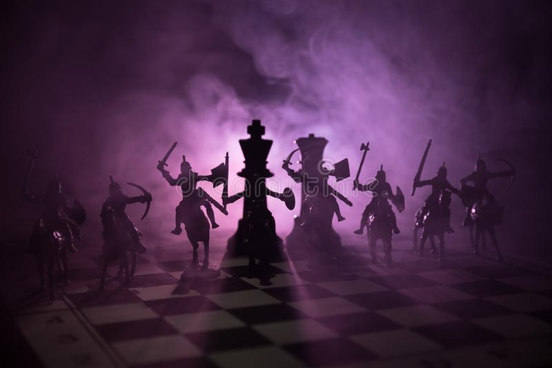 Medieval battle scene with cavalry and infantry on chessboard. Chess board game concept of business ideas and competition and stra stock photography