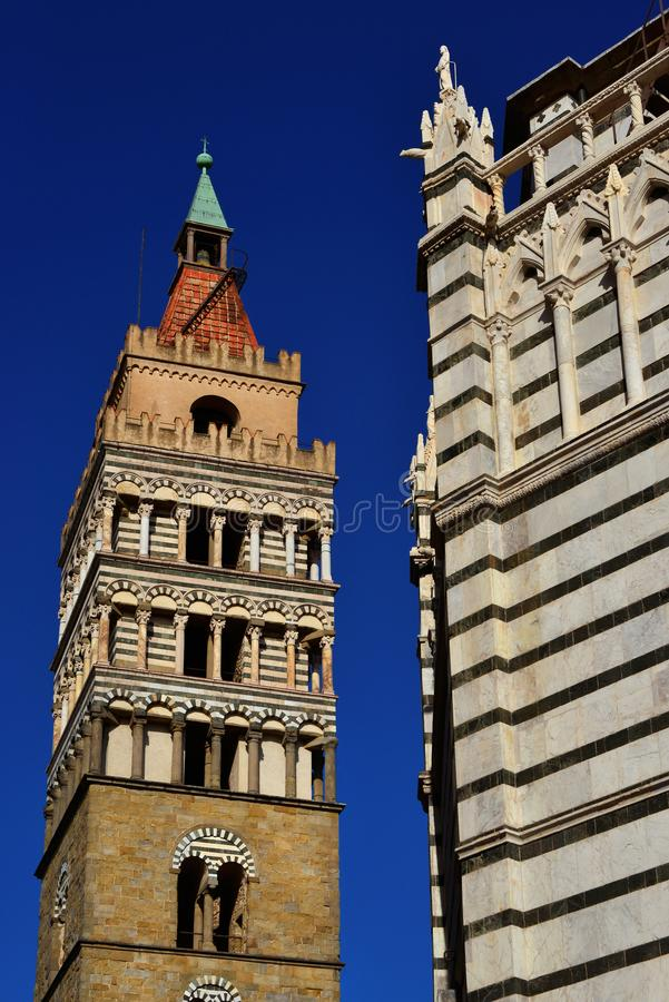 Medieval bell tower with Baptistry in Pistoia. Pistoia beautiful landmarks. Medieval bell tower and gothic Saint John Baptistry in the historic city center royalty free stock photos