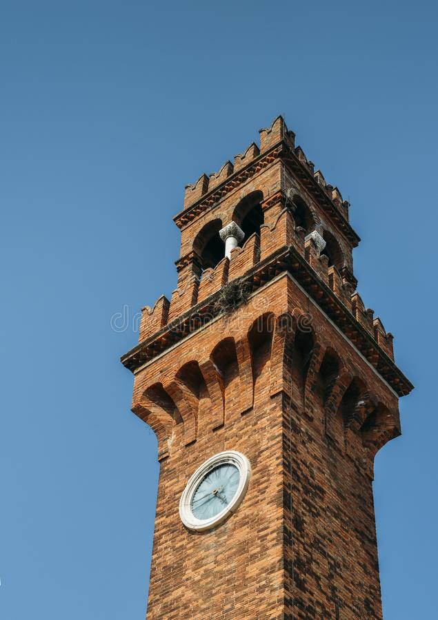 The medieval bell tower, or campanile, of San Stefano church, Murano, Venice. stock photo