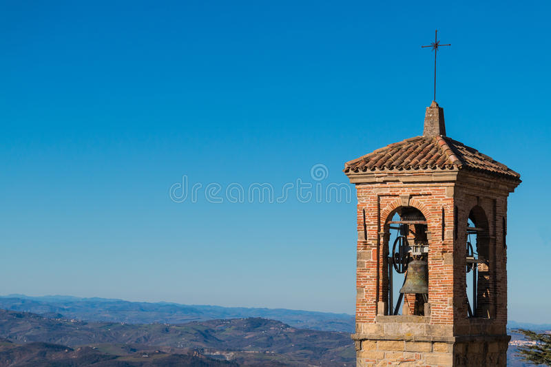 Medieval bell tower. Panorama - San Marino royalty free stock photography