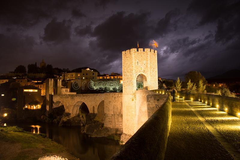 The Medieval bridge of the Besalu Catalonia, Spain stock photos