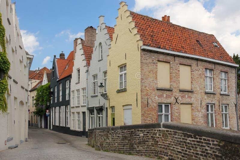 Medieval buildings in Peerdenstraat. Bruges. Belgium. Medieval houses in Peerdenstraat viewed from the bridge over Groenerei. Bruges. Belgium royalty free stock photography