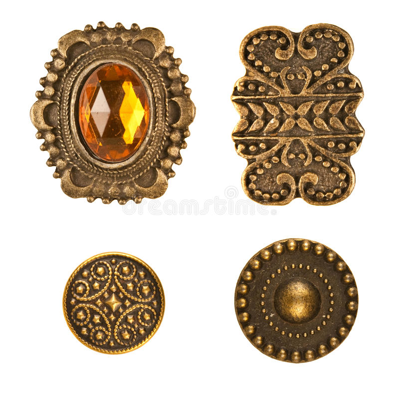 Medieval Buttons. Four different medieval bronze buttons arraged on white stock photography