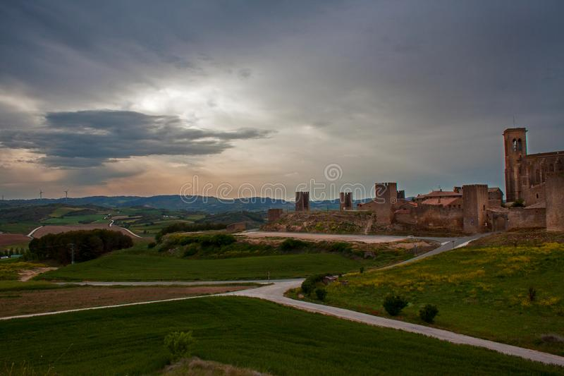 artajona, medieval castle of de Navarra, basque country in Spain in the morning light. royalty free stock photography