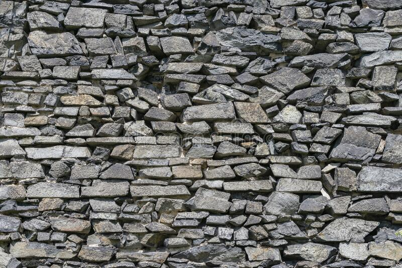 Medieval castle back basalt whinstone stone wall background stock photos