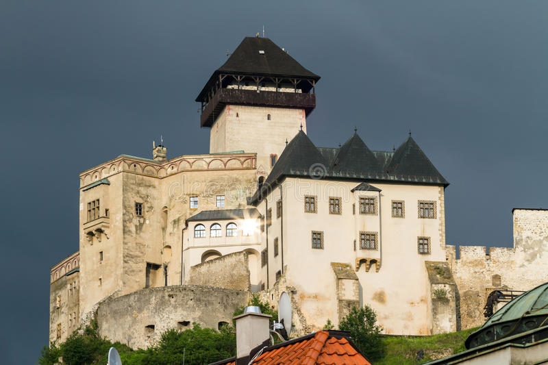The medieval castle of the city of Trencin in Slovakia. An ancient medieval castle on the hill light among green trees in the city of Trencin in Slovakia royalty free stock photo