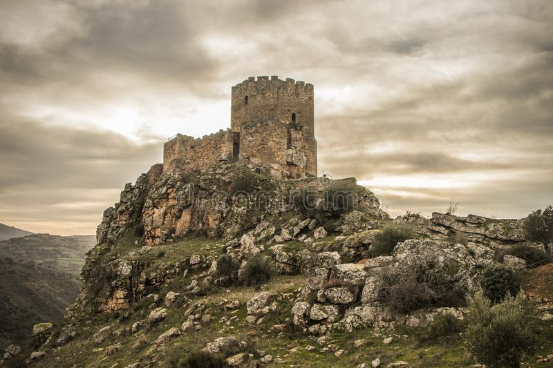 Medieval castle on a cliff on a cloudy day, Algoso, Vimioso, Miranda do Douro, Bragança, Tras-os-Montes, Portugal. Medieval castle on a rock cliff on a cloudy royalty free stock photos