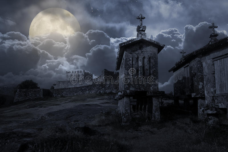 Medieval castle in a cloudy full moon night stock photo