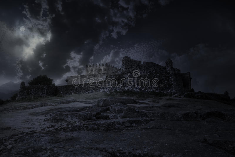 Medieval castle in a full moon night royalty free stock photo