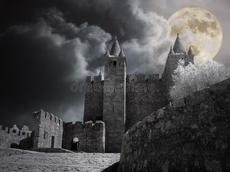Medieval castle in a full moon night royalty free stock photos