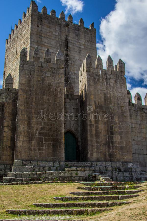 The medieval castle of Guimaraes. It has the status of a national monument and is referred to the seven wonders of Portugal stock photos