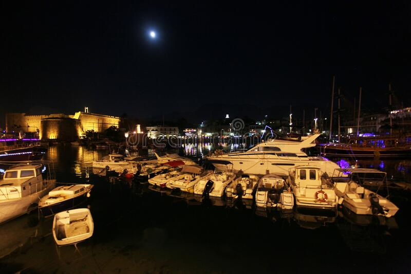 Medieval castle and harbor at night in Kyrenia-Girne. North Cyprus royalty free stock photo