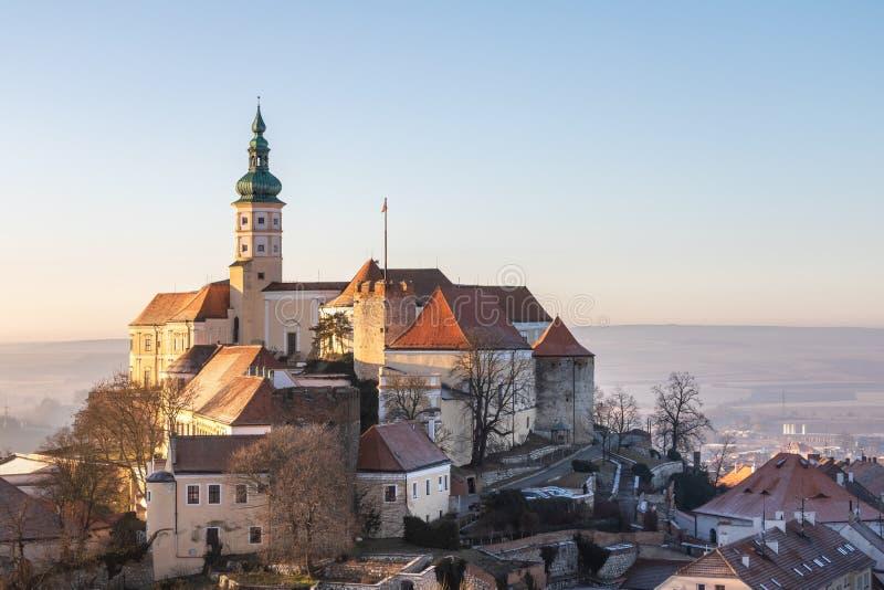Medieval castle in Mikulov city at dawn under blue sky stock image