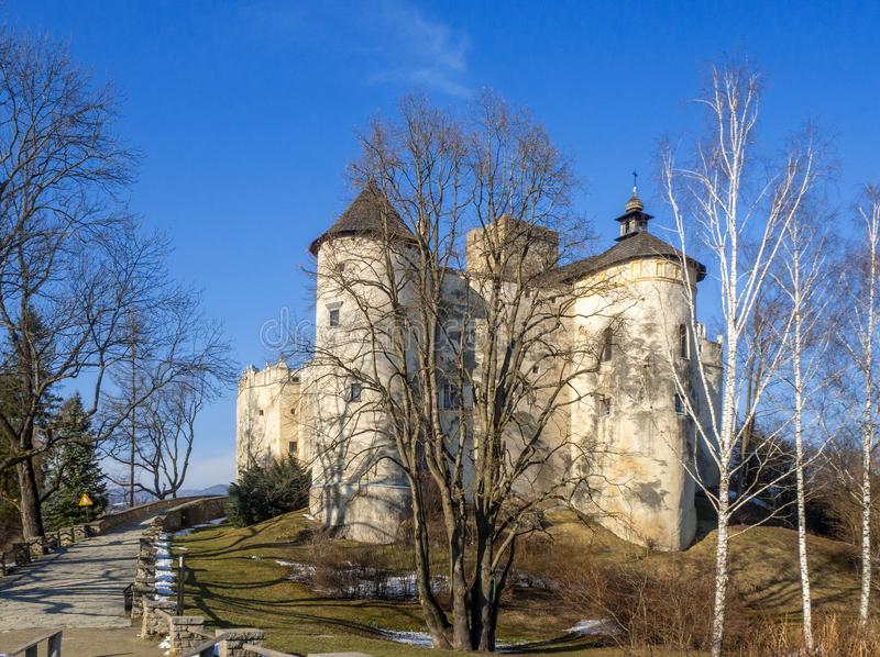Medieval Castle in Niedzica, Poland, in winter. Medieval Dunajec Castle in Niedzica, Poland, in sunset light in winter stock photography