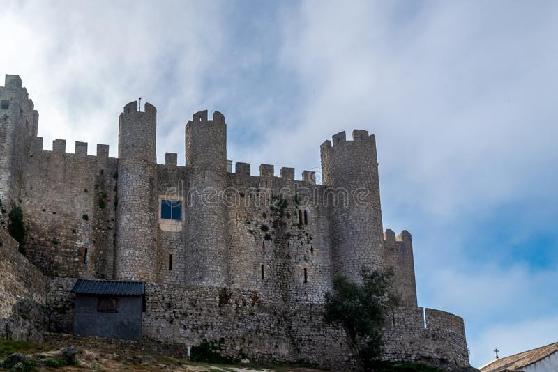 Medieval castle in the portuguese village of Obidos.  stock photo