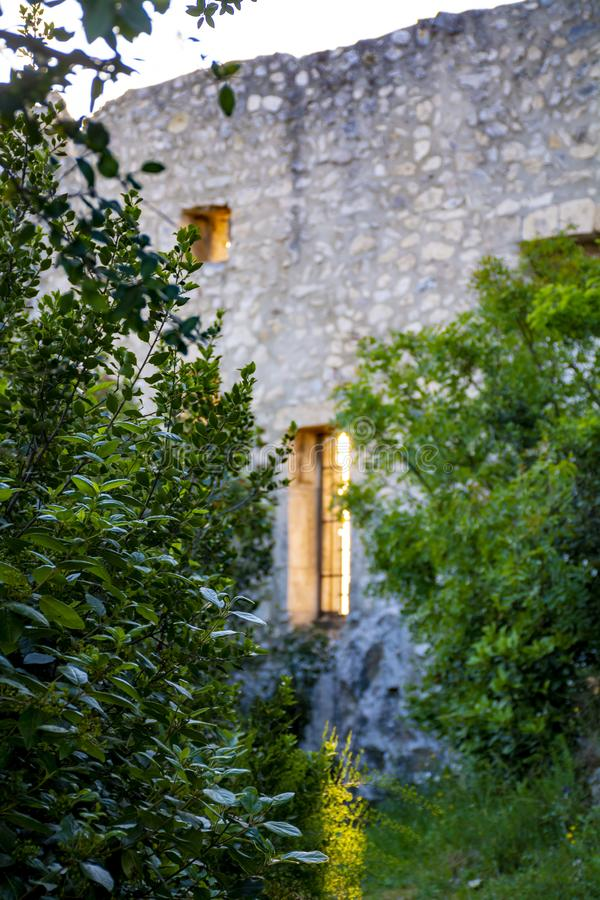 View on traditional medieval houses and castle ruines in Provence, South of France, vacation and tourist destination stock image