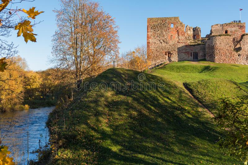 Medieval castle ruins near river in Bauska town, Latvia.  royalty free stock photo