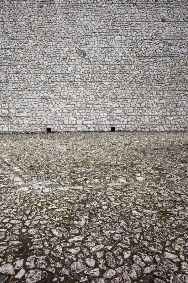 Medieval Castle Stone Wall And Courtyard Background royalty free stock photography