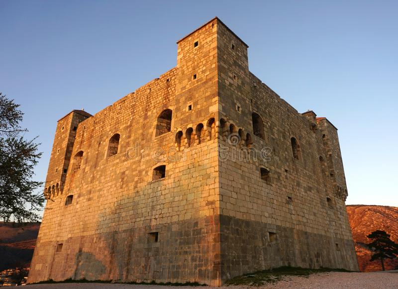 The medieval castle tower of the Croatian town of Senj, lit by the setting sun stock photos