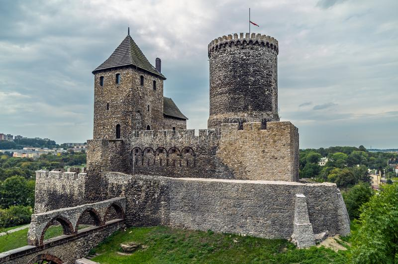 Medieval castle with tower and moat on the hill. royalty free stock photography