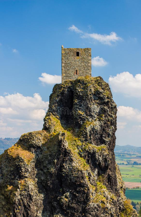 Medieval castle tower in the top of the rocky hillside. Medieval tower of the Trosky Castle on the rocky hill. Blue sky summer day picture. Trosky, Bohemian stock photos