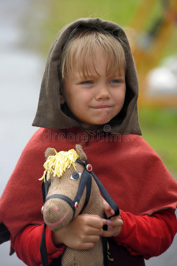 Medieval child with a toy horse royalty free stock image