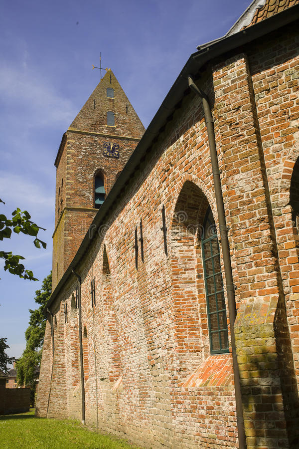 Medieval church in the Netherlands. The medieval Pancratius church in the small village of Godlinze in Groningen royalty free stock image