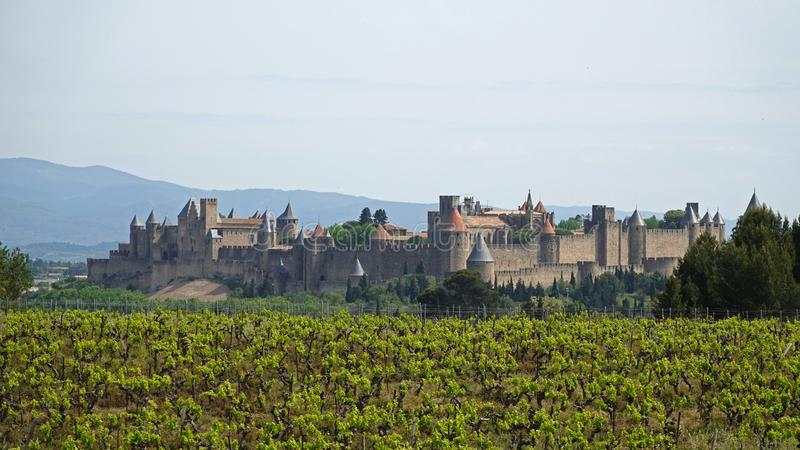 Medieval citadel of Carcassone sitting on the hill overlooking the winefields in France stock photo