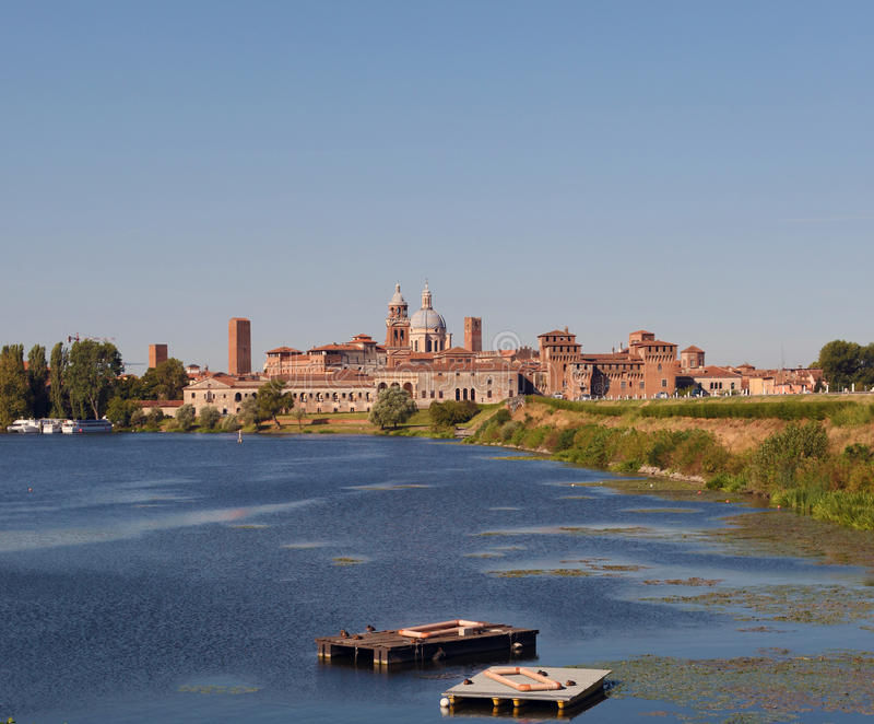 Medieval city of Mantova, Italy. Skyline view from the lake in front of the city stock photos
