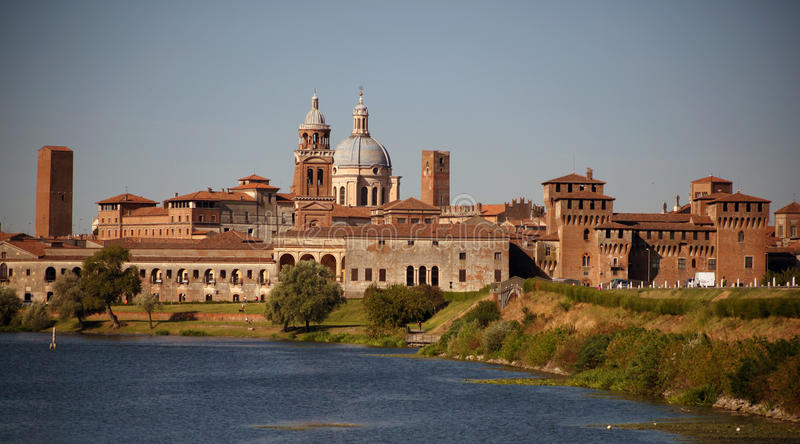 Medieval city of Mantova, Italy. Skyline view from the lake in front of the city royalty free stock photo