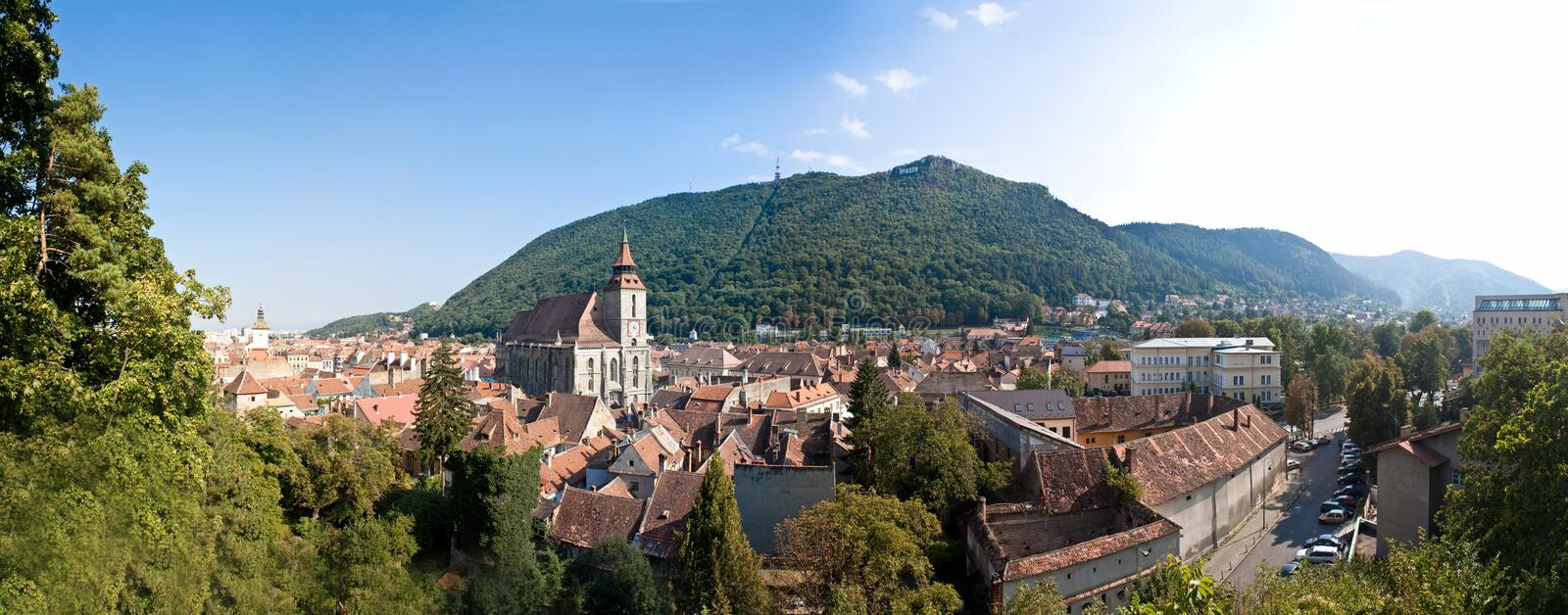 Medieval city panorama - Brasov, Romania. A panorama of the old part from Brasov, Romania. You can see many old buildings with the Black Church standing out. In stock photo