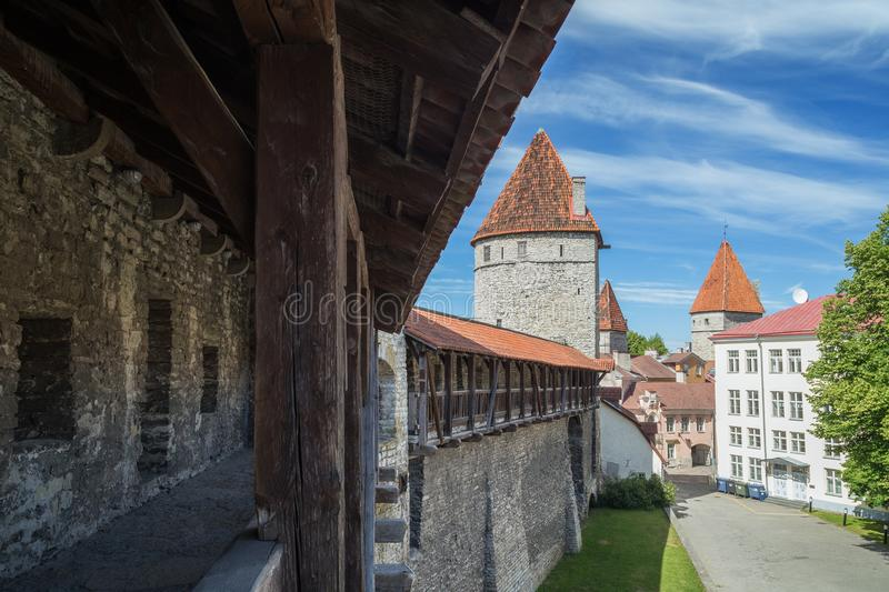 City wall at the Old Town in Tallinn. Medieval city wall or Town Wall or Walls of Tallinn and towers at the Old Town in Tallinn, Estonia, on a sunny day in the royalty free stock photography