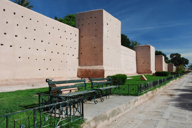 Medieval city walls around the medina of the city Marrakech. Made of orange-red clay and chalk which gives the city its nickname as the red city They were royalty free stock photos
