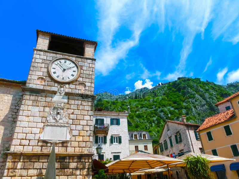 Medieval clock tower in Kotor in a beautiful summer day. Montenegro royalty free stock photography