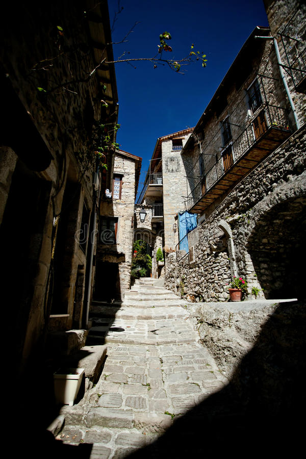 Medieval cobbled street in Peille, Cote d'Azur stock photography