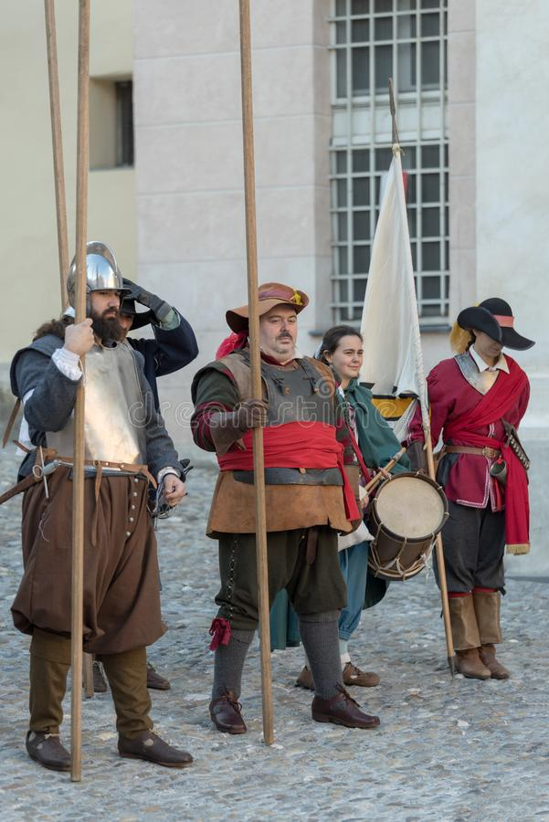 Medieval costume party. Taggia, Italy - March 17, 2018: Participants of medieval costume party in the historic city of Taggia in Liguria region of Italy. The royalty free stock photography