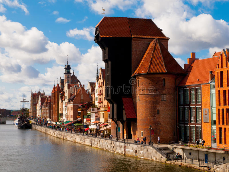 The medieval crane in Gdansk city centre. The medieval crane at Motlawa river in Old Town of Gdansk, Poland. Profile view stock photos