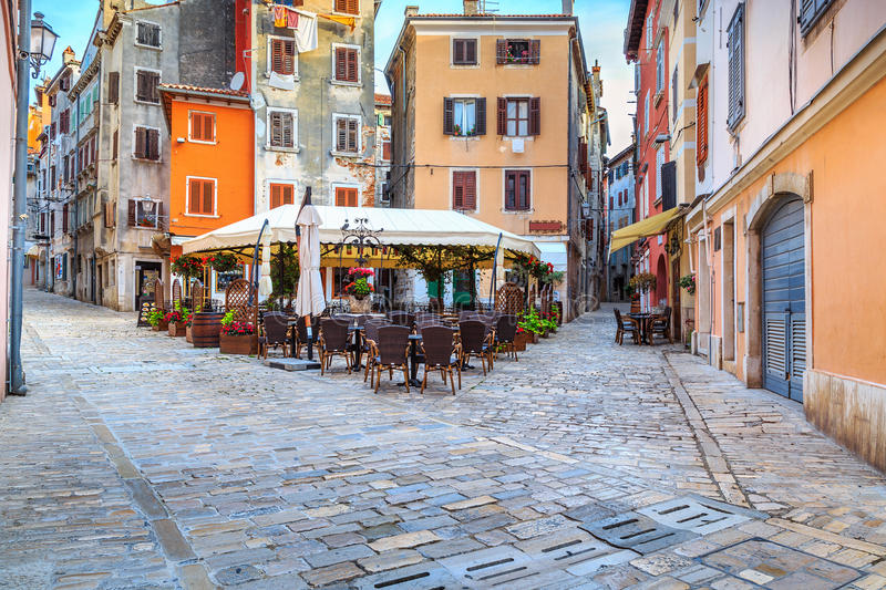 Medieval Croatian old street,with street cafe in Rovinj,Europe royalty free stock photos