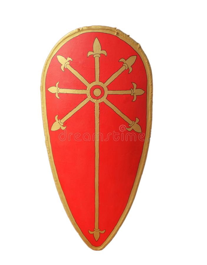 Medieval Crusader Knight`s Red Kite shield, golden fleur de lis stock photo