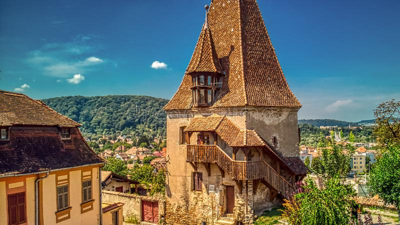 MEDIEVAL DEFENSE TOWER OF A EUROPEAN FORTRESS. One of the defense towers of the only still inhabited Medieval fortress in Europe - Sighisoara - Transylvania stock images