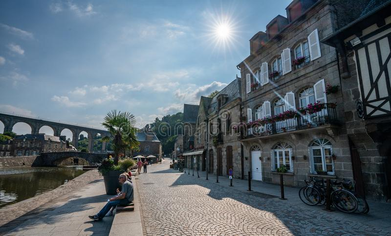 Medieval Dinan Port France on a sunny day with river view and half-timbered buildings. royalty free stock photo