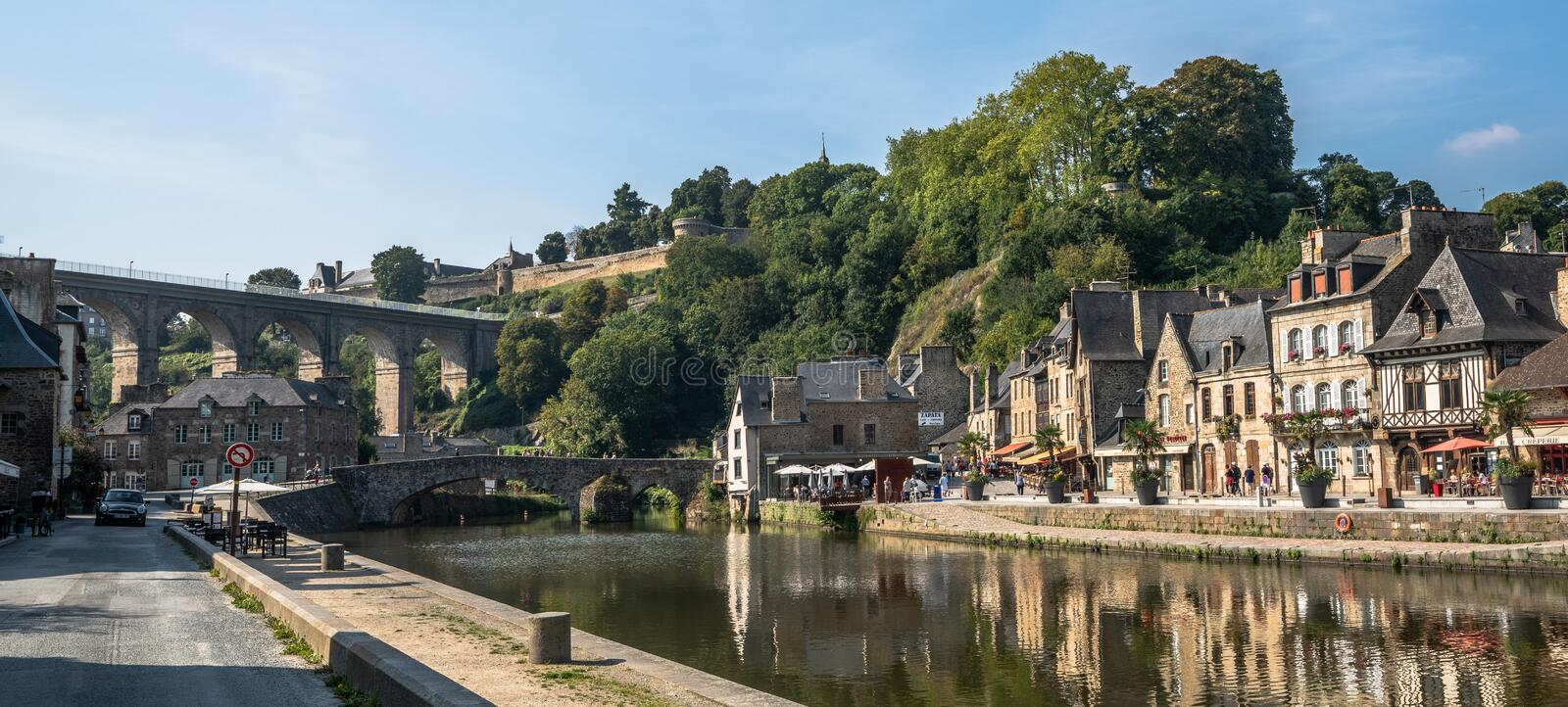 Medieval Dinan Port France on a sunny day with river view and half-timbered buildings. stock photo