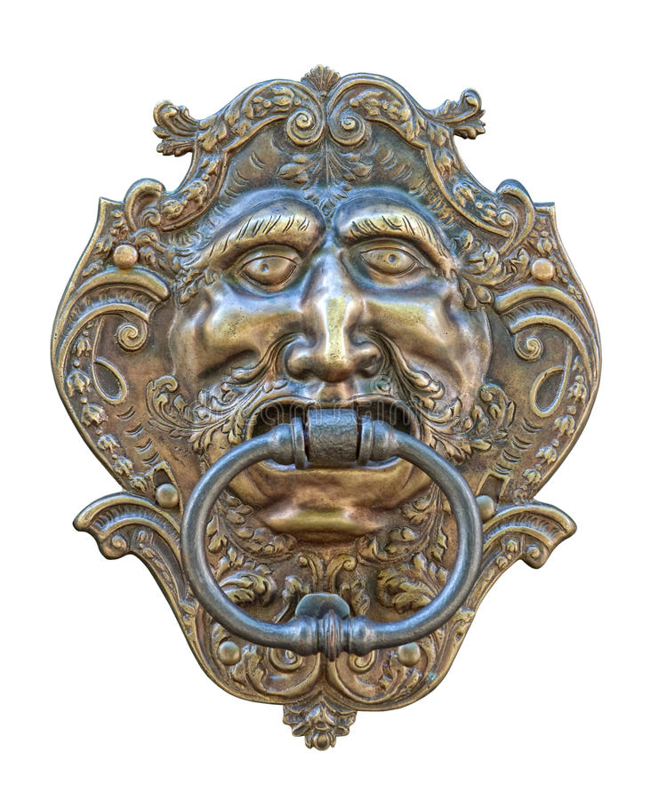 Medieval door knocker, bronze human head cutout stock photo